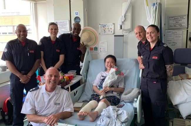 Firefighters visit Jing Li in hospital. Picture: London Fire Brigade
