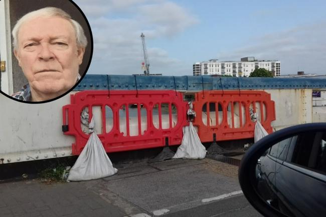 Len James is concerned about, among many things, the sandbags on the bridge