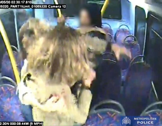 Handout CCTV grab issued by the Metropolitan Police of Melania Geymonat and her girlfriend Christine Hannigan being surrounded by a group on teenagers during an incident on a London bus in the early hours of May 30.  A teenager who admitted targeting a sa