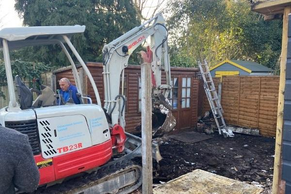 Contractors demolishing the extension