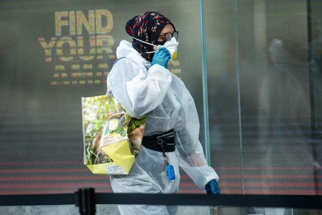 One shopper wore full PPE as she headed to Birmingham's Primark store on Monday (Jacob King/PA)