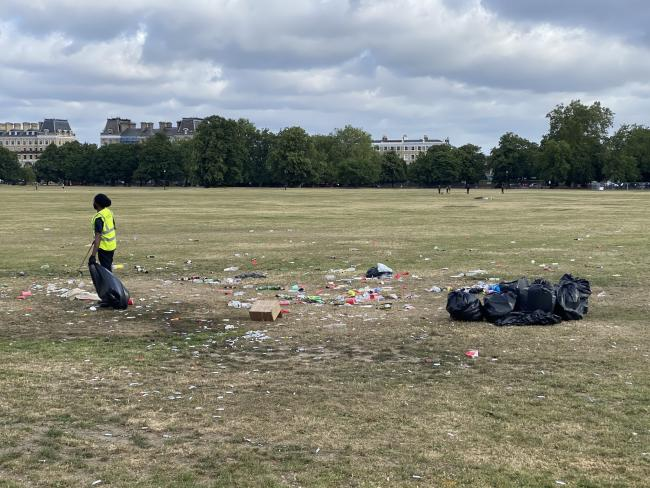 Council worker forced to clean up people's mess. Credit: Tom Morgan.