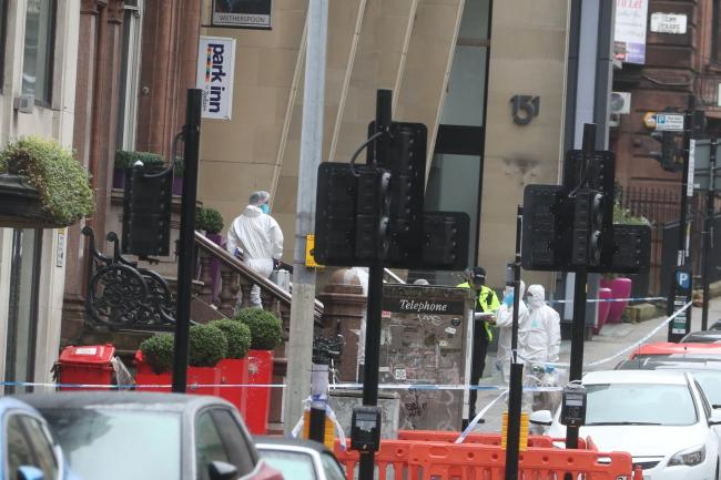 Forensic officers at the scene in West George Street, Glasgow, where a man was shot by armed officers