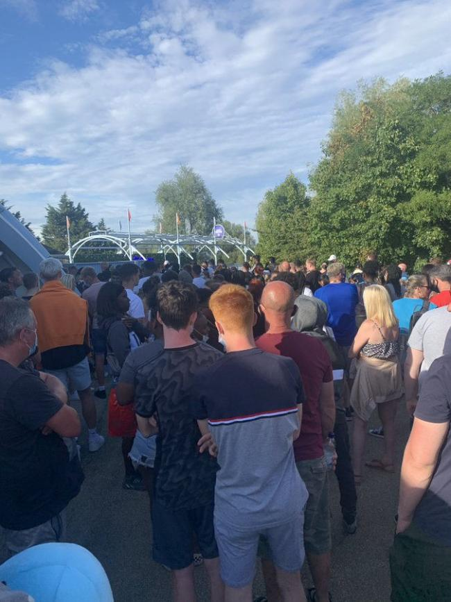 Photo taken with permission from the twitter feed of @abbiesear29 showing a crowd of people at Thorpe Park in Surrey after reports a police incident at the park on Saturday evening.