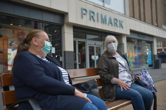 People wearing masks in Leicester city centre as face coverings become mandatory in shops and supermarkets in England. Jacob King/PA Wire