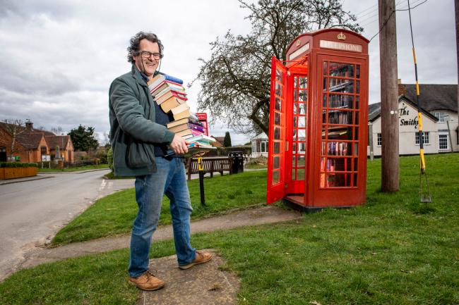 A phone box is turned into a community book exchange