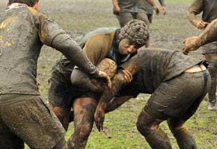 Wandsworth Guardian: Muddy marvels: Old Walcountians hooker Matt Houghton on the charge against Farnham during his side's 15-12 victory in atrocious conditions  Alun Stockton