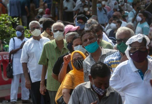 Wandsworth Times: People queue for a Covid-19 vaccine in Mumbai, India (Rafiq Maqbool/AP)