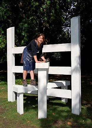Lucy Tomlins with her sculpture, entitled Concrete Country, in Battersea Park