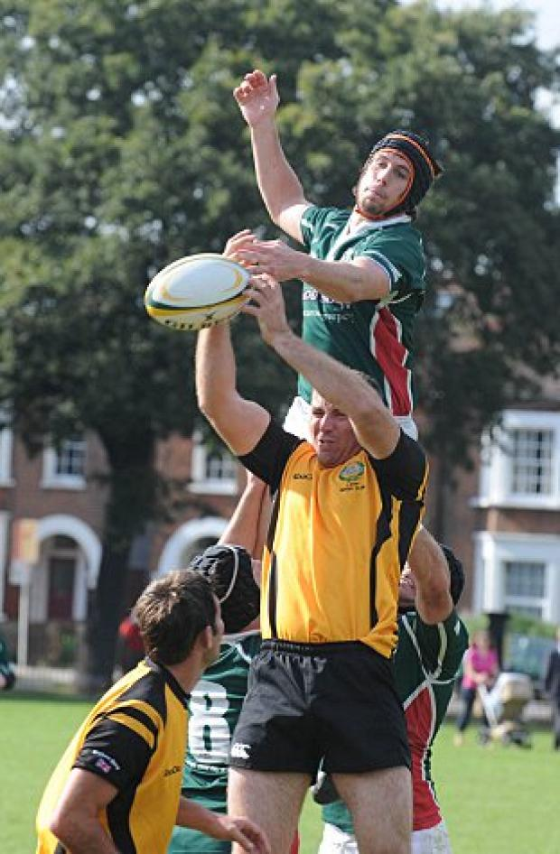 Eyes shut: The Royal Tank Regiment claim the ball from a line-out
