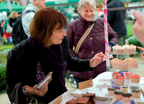 Tessa Jowell MP checks out the cupcakes on offer at the West Norwood Feast.