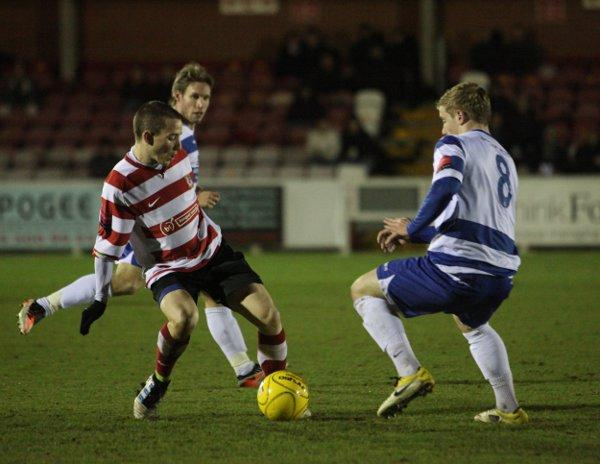 On the ball: Kingstonian new boy Ryan Woods puts the boot in against Margate on Monday