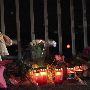 Tributes have been left on a bridge near the tunnel where a bus crashed in Switzerland, killing 28 people (Keystone)
