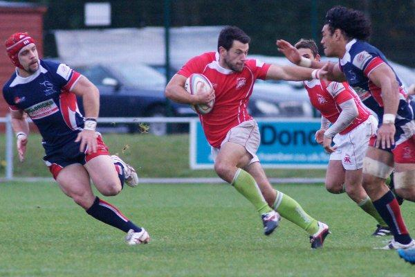 Get off: Simon Whatling, centre, in action for London Welsh Picture: Dave Jackson