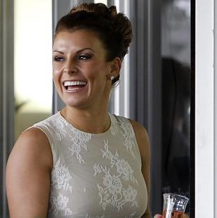 Coleen Rooney watches the racing at Aintree on day two of the Grand National meeting