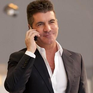 An unauthorised biography of Simon Cowell claims he goes through unusual procedures to look youthful