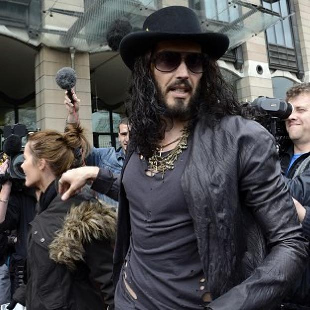 Russell Brand leaves Portcullis House, Westminster, after giving evidence to the Home Affairs Select Committee looking into drugs policy