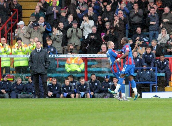 Going nowhere: Wilfried Zaha celebrates his goal on Saturday in front of the Cardiff bench with Matt Parsons