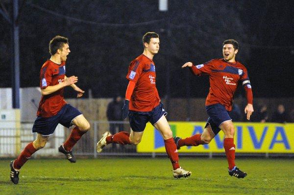Gone: Reece Jones, centre, celebrates scoring for Hampton & Richmond this season