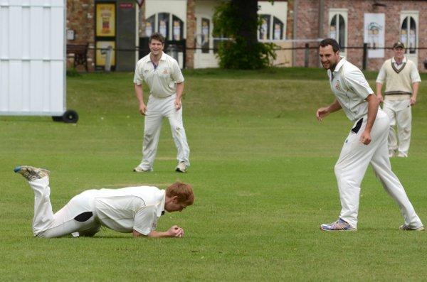 Safe hands: David Court clings on to the ball to dismiss Joel Pope on Saturday and give Anthony Caddy his second of four wickets