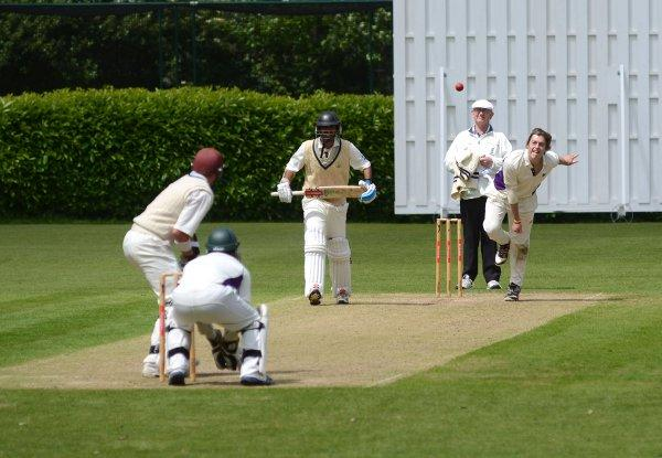 In credit:  Weybridge bowler James Crowson claimed 5-74 but couldn't stop his side losing by 215-runs to Sutton