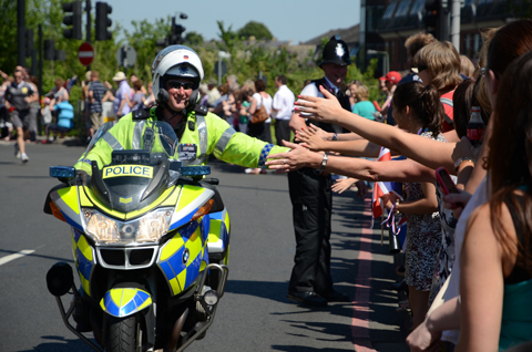 A police officer giving high fives as he made his way through Sutton