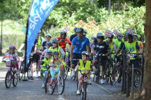 Gethin Jones joins families on bike ride