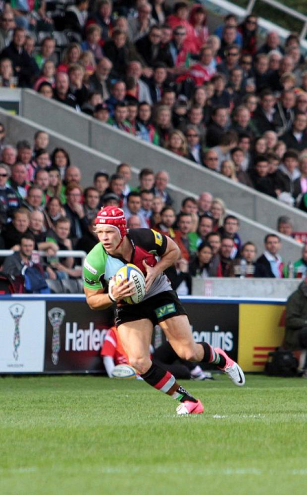 Determined: Quins cente Matt Hopper was up against it in Sunday's war of attrition with Saracens