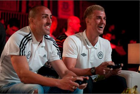 Liverpool's Jose Enrique playing Manchester City's Joe Hart during the Fifa 13 Celebrity Cup
