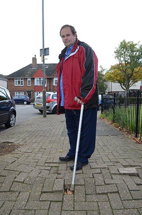Disabled man Martin Ellacott complains of shoddy paving work in Wandsworth