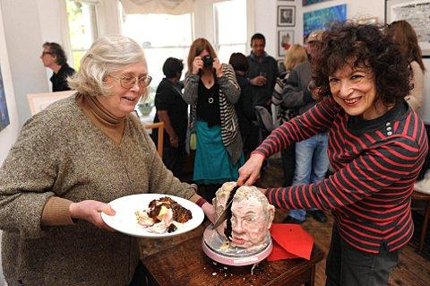 Phillipa Egerton and Diane Bindman smile as they carve