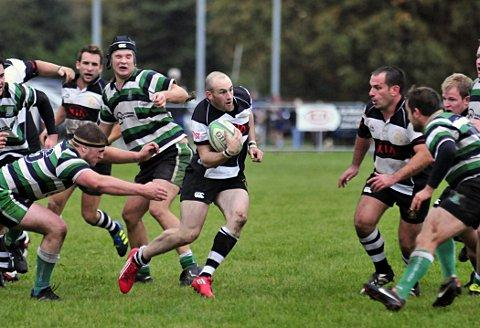Coming through: Mike Cartledge moves through the Tottonians defence