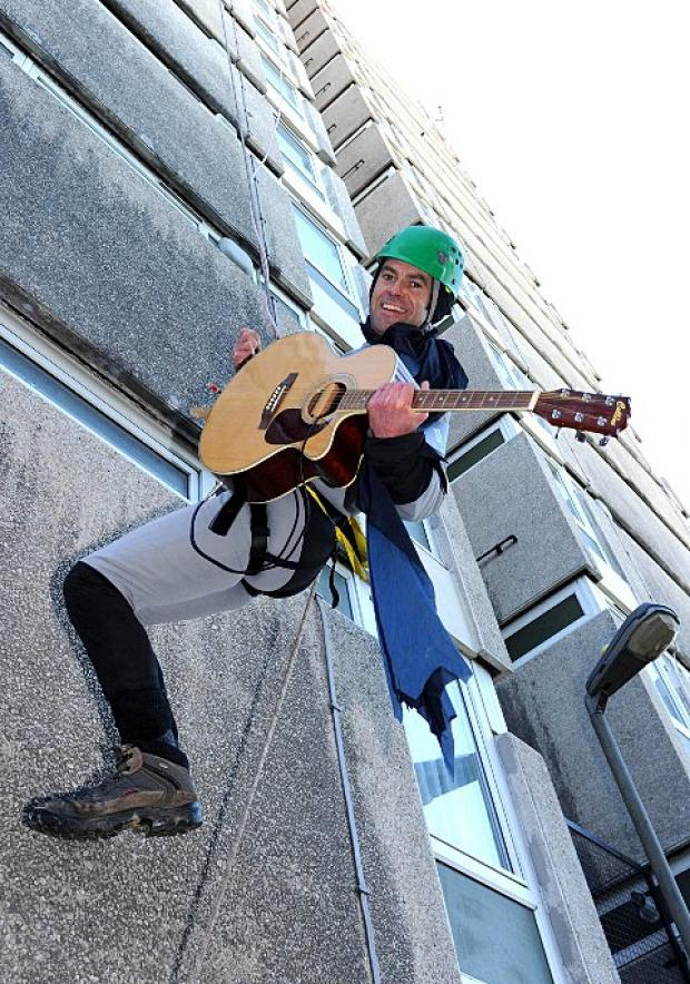 Alan Bond dressed as Batman abseils down Chillingford House
