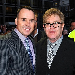 Sir Elton John and partner David Furnish are reported to be having a second baby