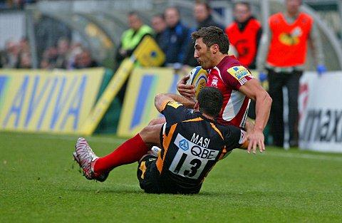Tough love: Gavin Henson is felled against London Wasps