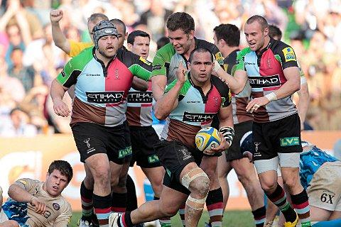 Team ethic: Quins prop Mark Lambert, left, is all about the team as he helps Maurie Fa'asavalu celebrate a try last year