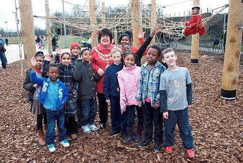 Councillor Jane Cooper with children celebrating the playground opening