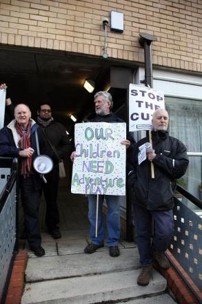 Eric Pickles greeted by protesters in Battersea