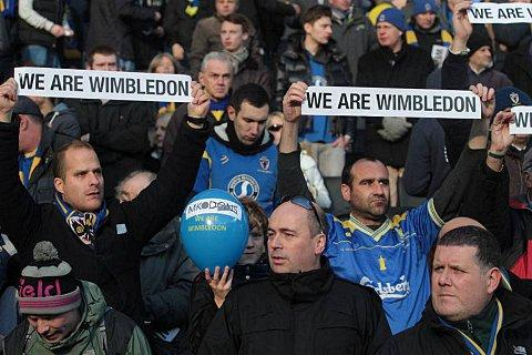Dons fans state their case during the FA Cup defeat at Stadium MK in 2013. Picture: MK Citizen