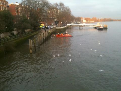 Life boat crews and police worked to pull the body from the river