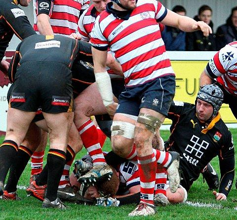 Try-tastic: Under this pile is Hugo Ellis, scoring one of his seven seven tries against Cambridge      Picture: David Whittam