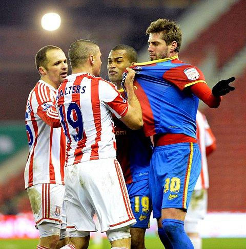 You and whose army? Andre Moritz and Jonathan Walters square up for a chat about the weather          Picture: Sentinel