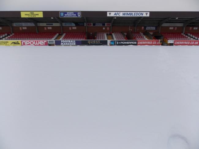 AFC Wimbledon appeals for help to clear snow covered pitch