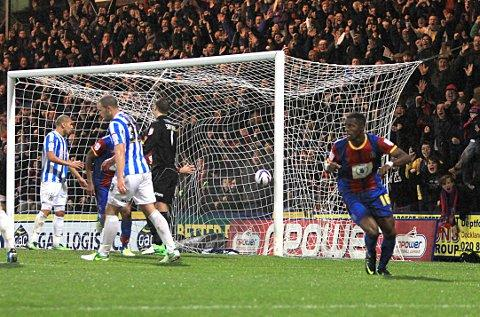Last goal for Palace: Wilfried Zaha scores against Huddersfield, it could be his last goal for Palace if the move to Old Trafford does not include a loan-back clause   SP70861