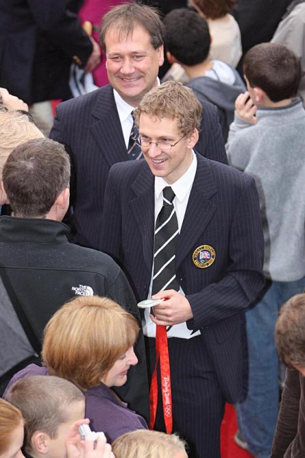 Wandsworth Guardian: Hero: Molesey Boat Club member Acer Nethercott with his Beijing silver medal at Barge Walk in 2008