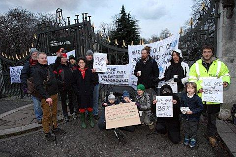 Protestors outside the playground before it was demolished