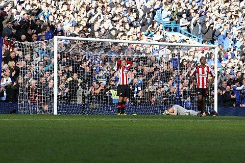 Decisive: Bees are down-hearted after Oscar scores Chelsea's all-important second goal at Stamford Bridge    SP74039