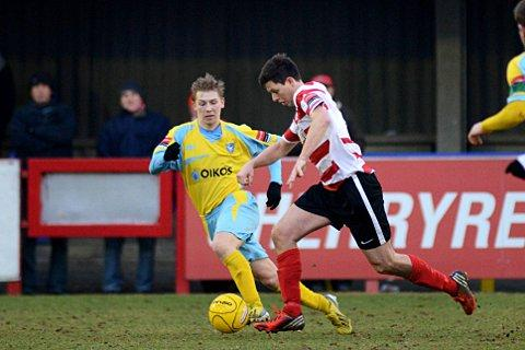 On the move: Matt Pattison takes on the Canvey defence in Saturday's 2-1 defeat    SP72984