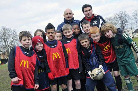 Visit: Wilkins meets some of Carshalton's youngsters 	SP73061