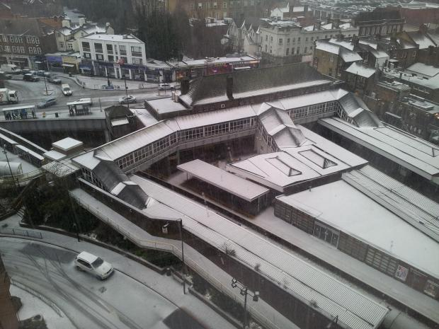 March madness: The rooftops of Sutton town centre were covered in white at lunchtime after snow and hail showers